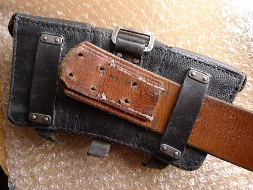 Nice woodwork find, belt, buckle and pouches.
