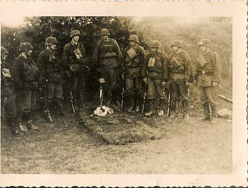 SS men burrying a fallen comrade,Interesting set of photos