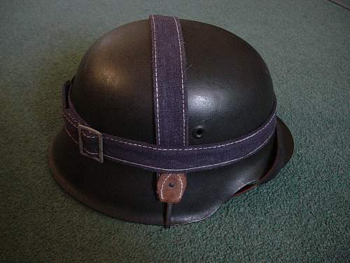 Click image for larger version.  Name:M42 helmet with Luftwaffe bread bag strap attatched..jpg Views:480 Size:241.7 KB ID:31584