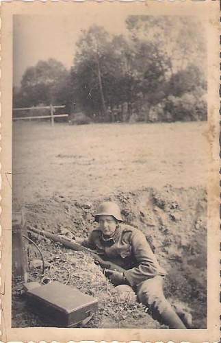 Click image for larger version.  Name:German WWII soldiers.jpg Views:73 Size:43.7 KB ID:421539
