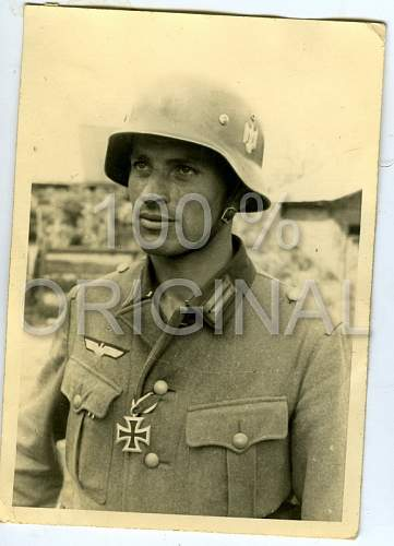 Click image for larger version.  Name:German Soldier Photo Helmet & Iron Cross.jpg Views:296 Size:125.9 KB ID:425134