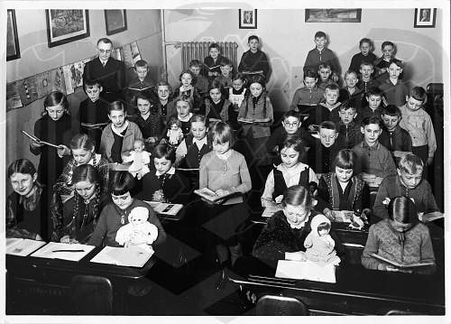 I want to share an interesting Third Reich children's classroom with you all