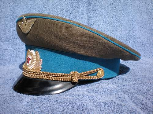 Trying to  identify Russian peaked caps