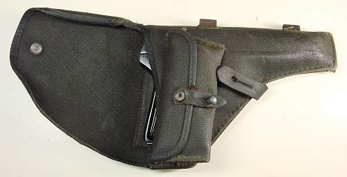 Click image for larger version.  Name:Tokarev TT-33 pistol and holster with the spare magazine in the holster magazine pouch.jpg Views:2019 Size:122.0 KB ID:70629