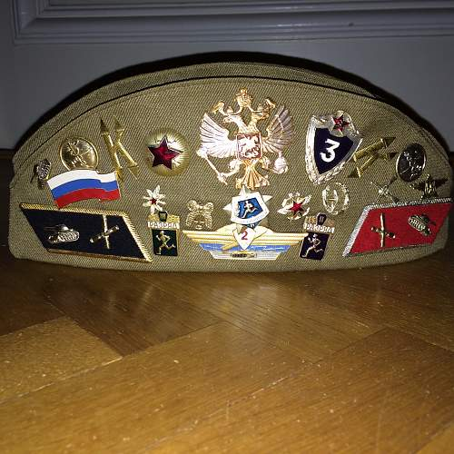 Pilotka covered with badges