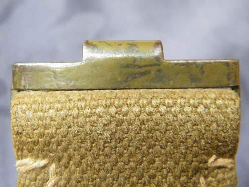 Dak/Trop web belt and associated buckle