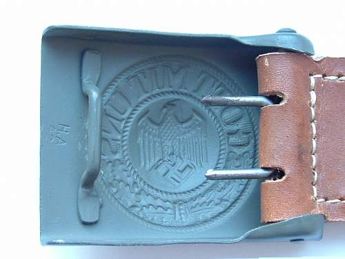 Belt end stamp: help with identification?
