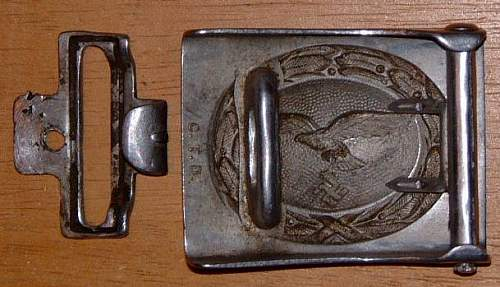 ID badge and belt buckles.