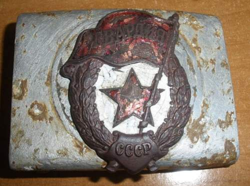 A tale of two soldiers: Heer buckle with Soviet Guards badge afixed.