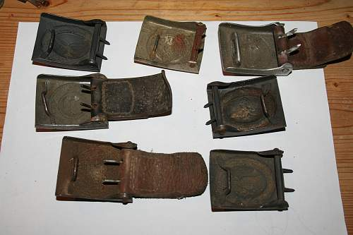 Wehrmacht belt buckles found uf an attic in Bavaria with a lot of medals and badges