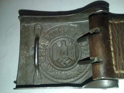 Help with reading a leather tab on a Heer Buckle?