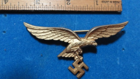 German Nazi Eagle w/ Swastika Pin (gold?) - swastika hanging from eagles claws