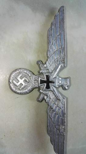 Luftwaffe and Wehrmacht and NSKOV cap badges