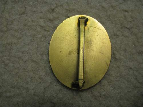 gold wound badge by 30, real or fake