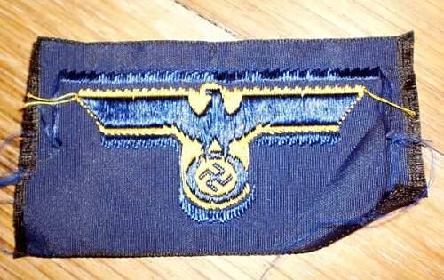 Some woolen KM badges.
