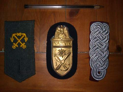 Lots of insignia, a Kriegsmarine dagger? and various unknown items.