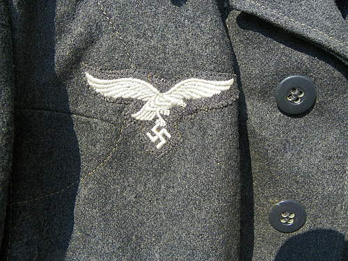 Flak-Regiment 4 and one unmarked tunic and a Greatcoat group find.