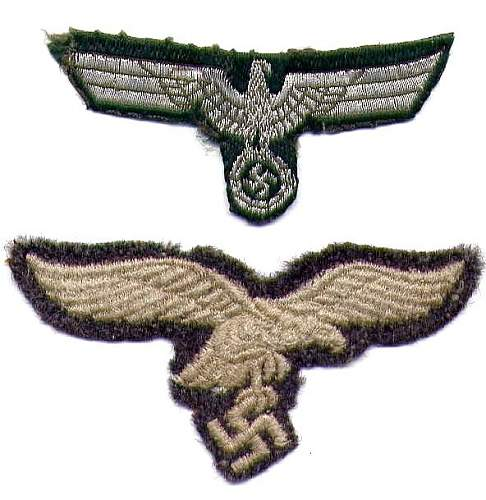 Two cap eagles: one Heer, one Luftwaffe.