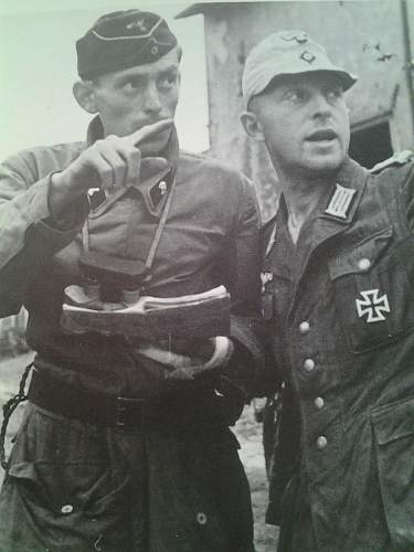 Click image for larger version.  Name:German Offiziers of the 21. Panzer-Division consult a map on the side of an Sd.Kfz. 251a.jpg Views:1895 Size:163.2 KB ID:536744