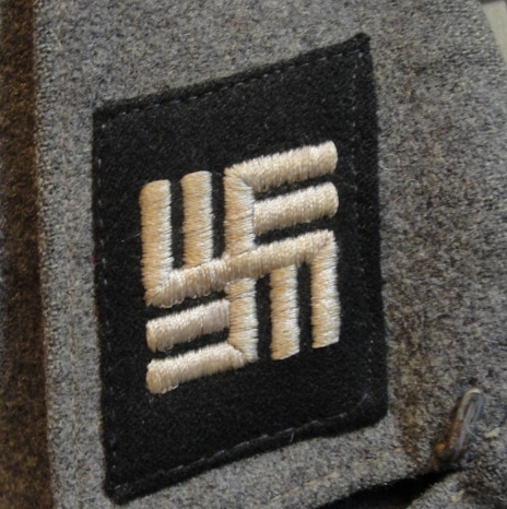 Luftwaffe tunic with concentration camp guard tabs