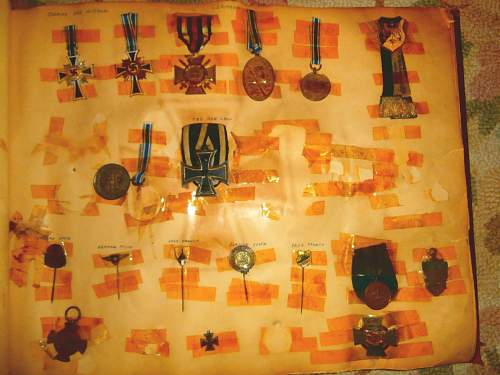 Click image for larger version.  Name:medals and pins in scrap book.jpg Views:60 Size:145.4 KB ID:602878