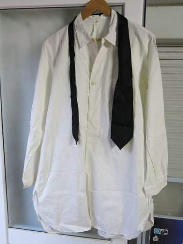 White officers shirt with black tie