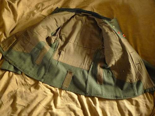 Pair of Heer tunics, early and late war.