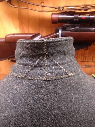 M42 Enlisted Man Tunic. Restored shoulder boards, most likely restored eagle. Junior collector seeking confirmation.