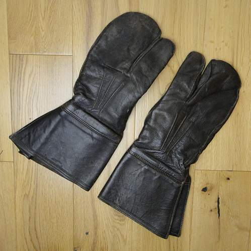 Unmarked leather gauntlets (mittens/gloves) with trigger finger. Stud reading SHB.