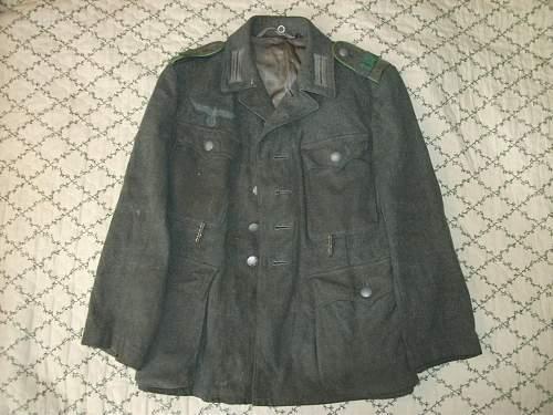 Heer M42 tunic. F 43 Depot marked. Combat worn.