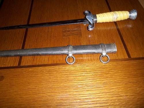 Alcoso officers dagger ........ i think it is a fake, help !