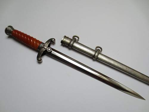 Early slant grip army dagger by Eickhorn