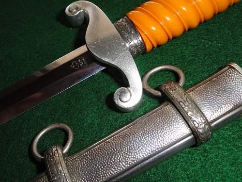 Early slant grip army by Puma w/ aluminum crossguard