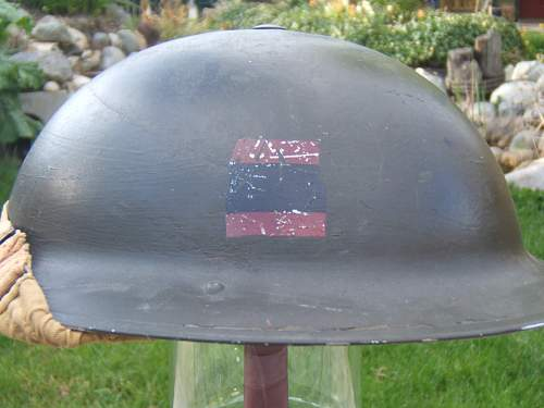British/Canadian Helmet insignia ID please