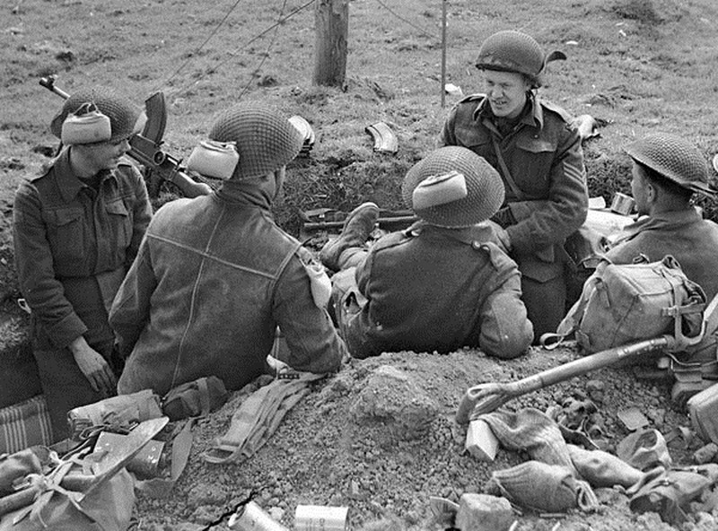 Why do you WW2 helmets have fishnets? : AskHistorians