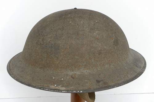 Click image for larger version.  Name:ww2britishhelmets 878_1280x853.jpg Views:80 Size:173.4 KB ID:315033