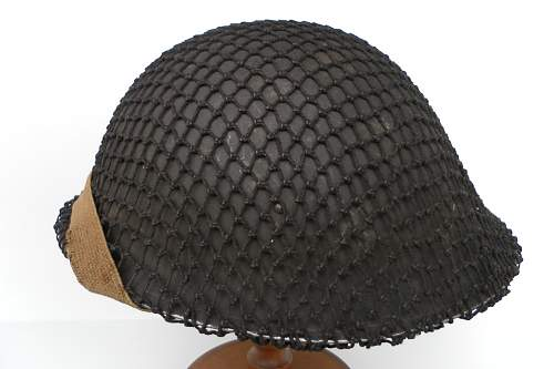 Click image for larger version.  Name:ww2britishhelmets 1660_1575x1050.jpg Views:209 Size:213.8 KB ID:403164