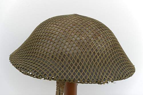 Click image for larger version.  Name:ww2britishhelmets 1598_1575x1050.jpg Views:193 Size:243.4 KB ID:403171