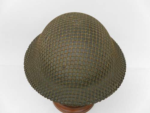 Click image for larger version.  Name:ww2britishhelmets 1880_1600x1200.jpg Views:121 Size:268.6 KB ID:418918