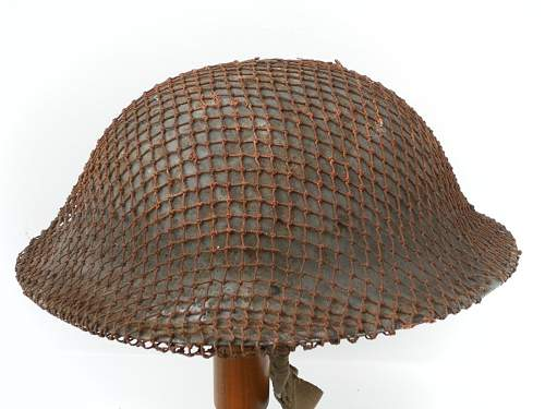 Click image for larger version.  Name:ww2britishhelmets 2043_1400x1050.jpg Views:61 Size:266.6 KB ID:429462