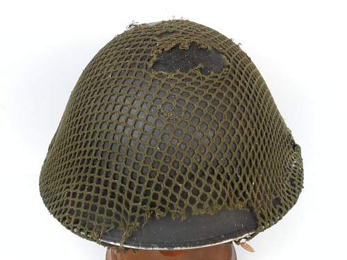 Click image for larger version.  Name:ww2britishhelmets 2166_1400x1050.jpg Views:80 Size:239.8 KB ID:437014