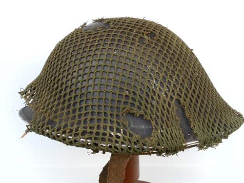 Click image for larger version.  Name:ww2britishhelmets 2167_1400x1050.jpg Views:63 Size:254.3 KB ID:437015