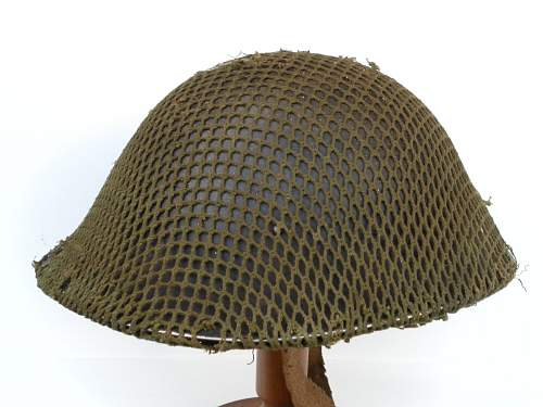 Click image for larger version.  Name:ww2britishhelmets 2169_1400x1050.jpg Views:62 Size:223.5 KB ID:437016