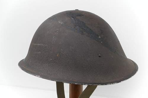 Click image for larger version.  Name:ww2britishhelmets 1562_1575x1050.jpg Views:106 Size:190.9 KB ID:443221