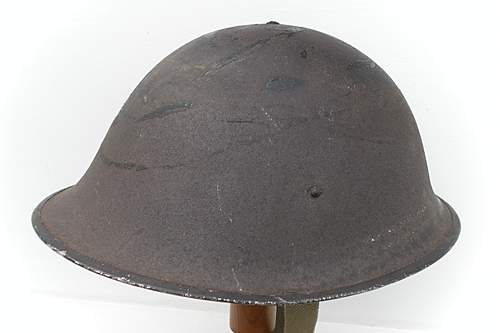 Click image for larger version.  Name:ww2britishhelmets 1564_1575x1050.jpg Views:99 Size:215.9 KB ID:443222