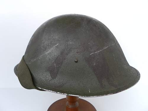 Click image for larger version.  Name:ww2britishhelmets 2191_1400x1050.jpg Views:155 Size:196.1 KB ID:443231