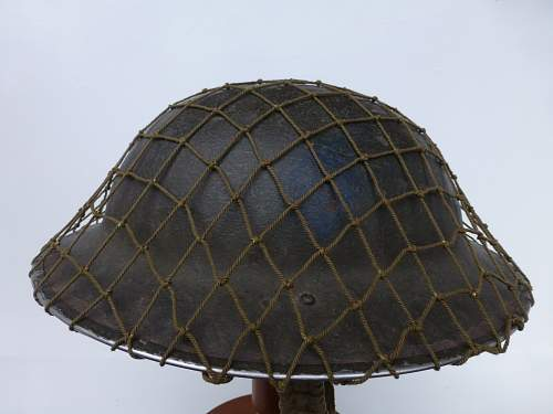 Click image for larger version.  Name:ww2britishhelmets 2302_1400x1050.jpg Views:58 Size:219.9 KB ID:449184