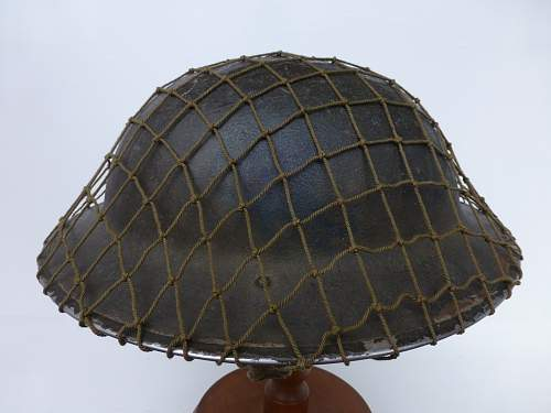 Click image for larger version.  Name:ww2britishhelmets 2303_1400x1050.jpg Views:53 Size:226.5 KB ID:449185