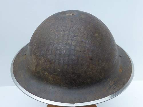 Click image for larger version.  Name:ww2britishhelmets 2773_1400x1050.jpg Views:12 Size:196.7 KB ID:492447