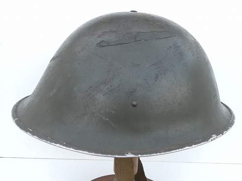 Click image for larger version.  Name:ww2britishhelmets 213_1024x768.jpg Views:35 Size:98.7 KB ID:502636